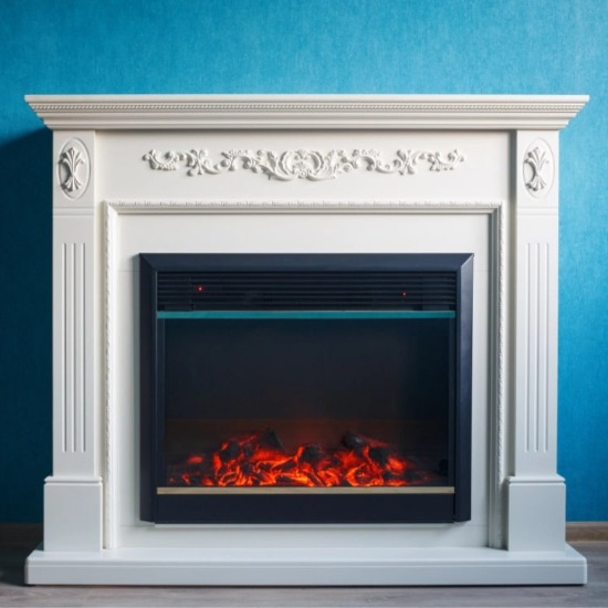 An electric fireplace installed on a blue wall